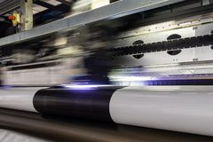 Big professional printer, processing massive vinyl rolls. royalty free stock photography