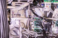 Big professional printer, detailed shot of the motherboard and the wiring system royalty free stock photography