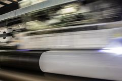 Big professional printer, processing massive vinyl rolls. stock photos