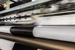 Big professional printer, processing massive vinyl rolls. royalty free stock image