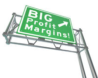 Big Profit Margins Freeway Road Sign Increase Net. Big Profit Margins words on a green freeway road direction sign to point you in the direction of increasing Stock Photo