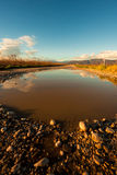 Big puddle in the country Stock Photography