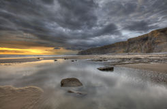 Big Puddles. During Sunset at the Heritage Coast Royalty Free Stock Photo