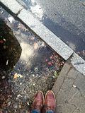 Big puddles at streets on a rainy day Royalty Free Stock Images