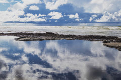 Big puffy clouds above sea Royalty Free Stock Photo