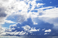 Big puffy clouds above sea Royalty Free Stock Photos