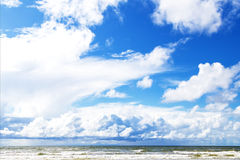 Big puffy clouds above sea Royalty Free Stock Image