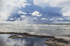 Big puffy clouds above sea Royalty Free Stock Images
