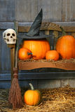 Big pumpkin with black witch hat and broom. Big pumpkin with black witch hat on bench for Halloween Stock Photos