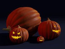 A big pumpkin and jack-o'-lanterns carved for Halloween. Rendered image of a fat pumpkin and three jack-o'-lanterns with evil glowing faces Stock Image