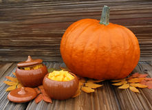 Big pumpkin and pottery with pumpkin slices Royalty Free Stock Images