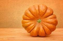 Big pumpkin on a table-top Royalty Free Stock Photo