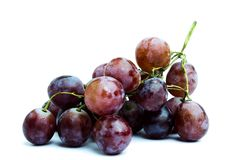 The big purple grapes on a white background Royalty Free Stock Photo