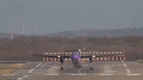 Big purple violet passenger train takes off the landing strip runway at airport. Big purple violet passenger train takes off the landing strip runway airport stock video