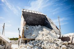Big quarry truck unloads white limestone gravel to crushed stone quarry , limestone mining stock photography