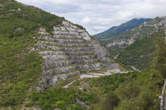 Big quarry under the sky in italy at toirano stock photos