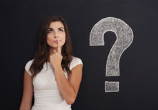 Big question mark. Woman with question mark on blackboard royalty free stock photo