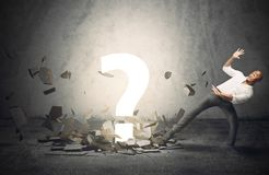 Big question point. Businessman frightened by a big question point stock images