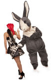 Big rabbit flirting with cute girl Stock Photo