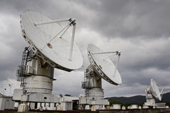 Big radio telescope on cloudy sky background Royalty Free Stock Photos