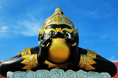 Big Rahu eat the moon sculpture in temple Stock Photo