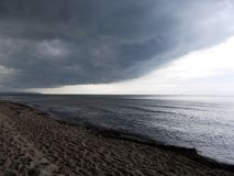 Big rain cloud coming on sandy beach on the baltic sea in Poland royalty free stock photography