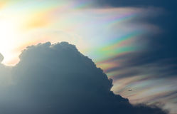 Big rainbow cloud and small plane Stock Image