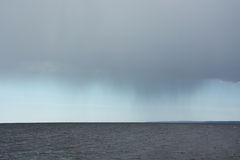 Big rainy clouds over the sea Royalty Free Stock Images