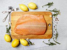 Big raw salmon fillet on wooden tray Stock Photography