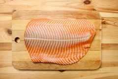 Big raw salmon fillet on wooden tray Royalty Free Stock Images
