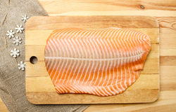 Big raw salmon fillet on wooden tray Royalty Free Stock Photos
