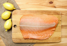 Big raw salmon fillet on wooden tray Royalty Free Stock Photography