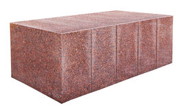 The big rectangular street red granite block. The big rectangular street solid  block from red granite. Isolated on white outdoor shot Royalty Free Stock Image