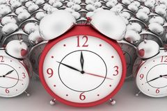 Big red alarm clock and alarm clocks on white Stock Image