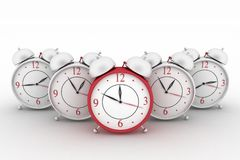 Big red alarm clock and alarm clocks on white Royalty Free Stock Image