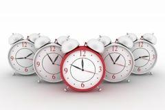 Big red alarm clock and alarm clocks on white. 3d big red alarm clock and alarm clocks on white Royalty Free Stock Image