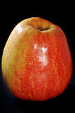 The big red apple. On a black background Royalty Free Stock Photo