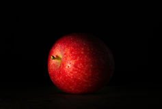 Big red apple in drops of wate. R close-up on a dark background Stock Photography