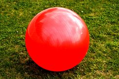Big red ball alone Stock Photo