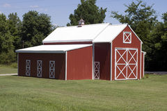Big Red Barn. This big red barn is seen at the edge of town Royalty Free Stock Image
