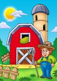 Big red barn with farmer Stock Image