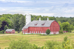 Big Red Barn. A large red barn with a tall white silo stand in scenic Door County, Wisconsin Royalty Free Stock Photo