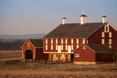 Big Red Barn taken in the Morning. Photograph of a large historic red barn taken in the early morning light Royalty Free Stock Photos