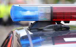 big red and blue flashing lights on the police car during the re Royalty Free Stock Images