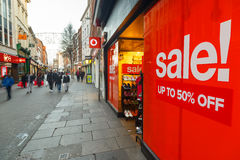 Big red Boxing Day sales poster and shoppers on Clumber Street i Royalty Free Stock Image