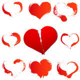 Big red broken heart on white isolated background and set of a grunge hearts Stock Images