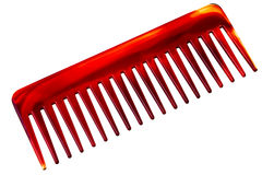 Big red and brown comb. Big red and brown comb isolated over white background Royalty Free Stock Images