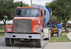 Big Red Cement Truck. A big red cement truck working in a residential neighborhood stock photography