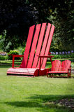 Big red chair Stock Images