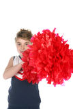Big red cheerleader's pompom. Cute girl holding big red cheerleader's pompom Royalty Free Stock Photo